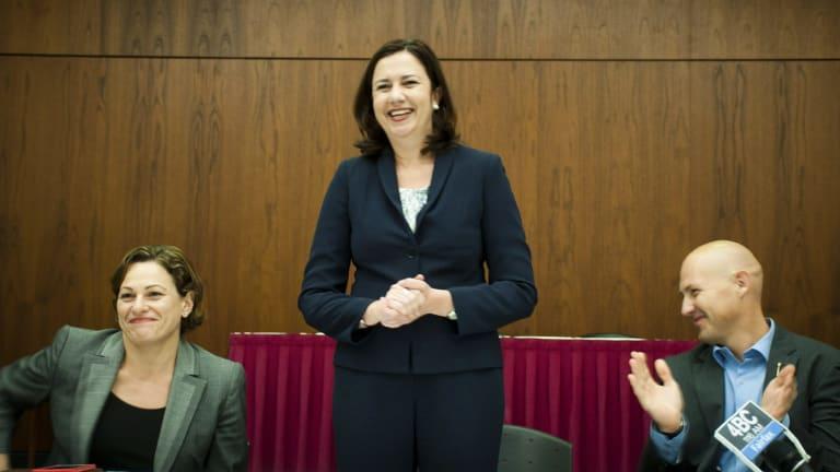 Labor's Caucus welcomes Premier Annastacia Palaszczuk, with Deputy Premier Jackie Trad and Treasurer Curtis Pitt.