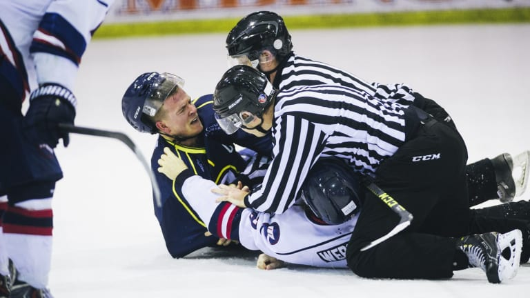 Two referees break up a fight between Brave's Jordan Gavin and Ice's Lliam Webster.