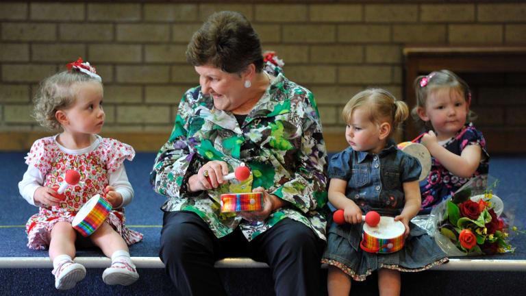 Joan Kirner at Sunbury Neighbourhood House in 2012 with members of the Mini Maestros.