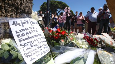 Floral tributes are laid out near the site of the truck attack in the French resort city of Nice on Friday.