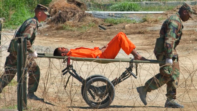 A detainee from Afghanistan on his way to interrogation at Camp X-Ray.