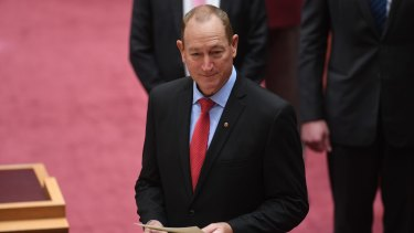 Senator Fraser Anning reads the oath of office as he is sworn in on Monday.