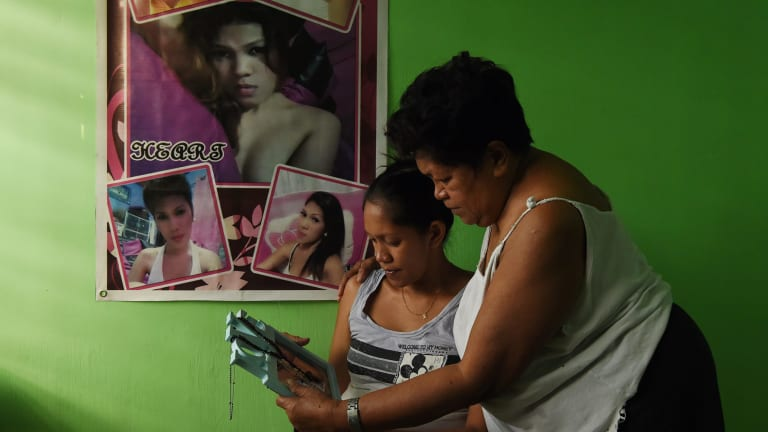In hiding Elena de Chavez, right, with her daughter Arriana de Chavez look at a photo of her transgender daughter Heart.