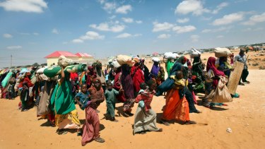 Families internally displaced by drought arrive at makeshift camps in the Tabelaha area on the outskirts of Mogadishu, Somalia.