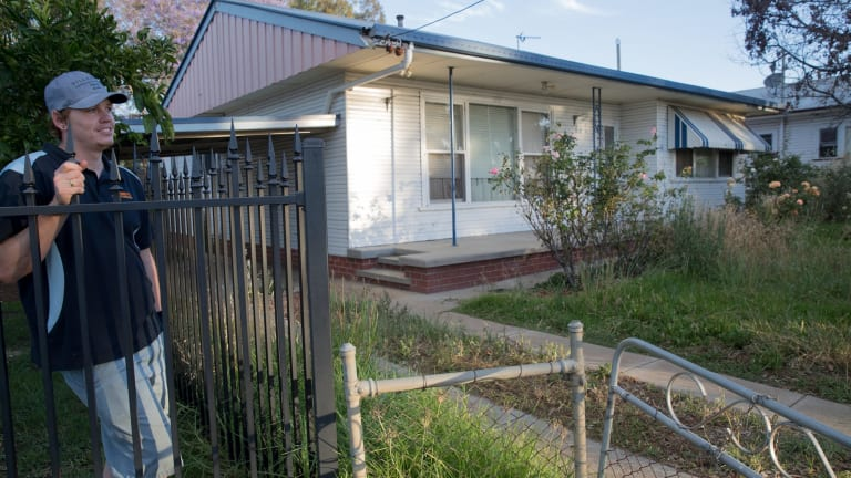 Lucas Shirdon looks at the overgrown garden in his neighbouring home in South Tamworth, one of many properties rented by Frank Lin.