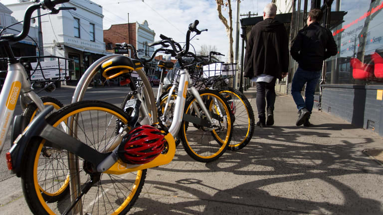 """oBikes seen on Swan Street in Richmond, which is now home to """"hundreds"""" of the distinctive bikes, according to locals."""