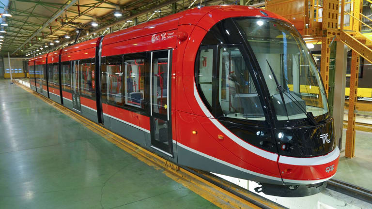 ACT Chief Minister Andrew Barr inspects Canberra's new trams on the production line in Spain.