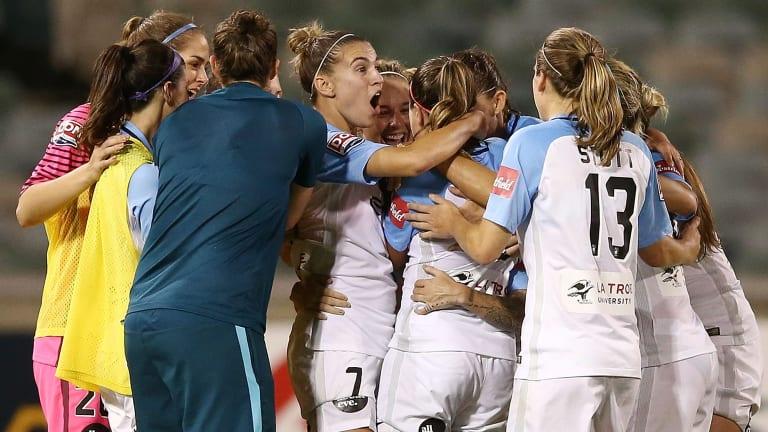 Jessica Fishlock of Melbourne City celebrates scoring the matchwinner with teammates.