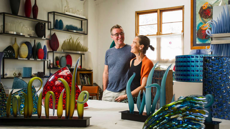 Glass artists husband and wife team, Matt Curtis and Harriet Schwarzrock, in their studio in Queanbeyan.