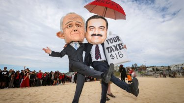 Protesters dressed as Malcolm Turnbull and Gautam Adani at Bondi Beach on Saturday.