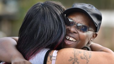 Velma Aiken, the paternal grandmother of Kamiyah Mobley, who was kidnapped as an infant 18 years ago, gets a congratulatory hug from a family member after Mobley was found on January 13.