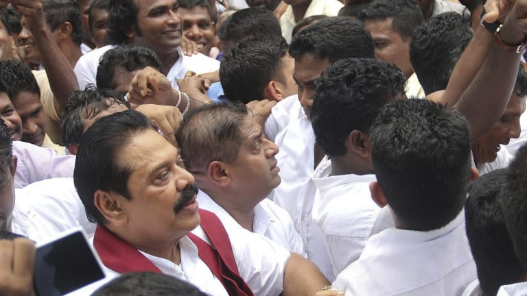Former Sri Lankan president Mahinda Rajapaksa with supporters on Wednesday.