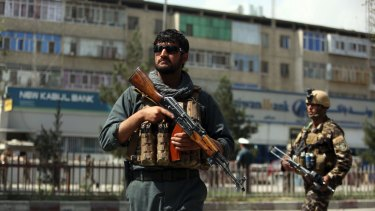 Afghan security personnel arrive at the site of a suicide bombing in Kabul, Afghanistan, on Tuesday.