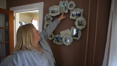 Teri Kroll with photos of her son Tim.