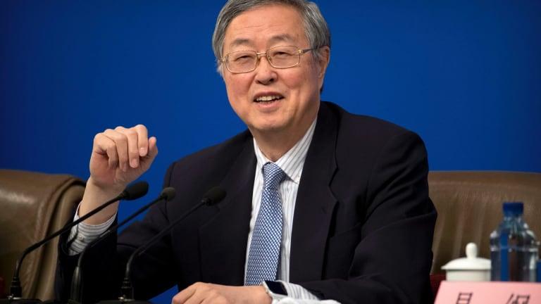 "PBoC governor Zhou Xiaochuan, left, spoke of ""fierce market reactions""."