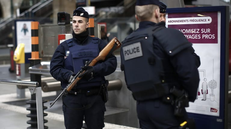 French police officers patrol the platforms at the Gare du Nord train station in Paris, France on Saturday.