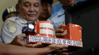 Head of Indonesian National Transportation Safety Committee Tatang Kurniadi shows the recovered Cockpit Voice Recorder.