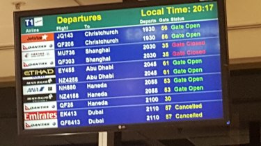 The departures board at Sydney Airport on Wednesday night, showing cancelled flights to Dubai.