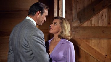 Neanderthal in a sharp suit: Honor Blackman as Pussy Galore with Sean Connery in <i>Goldfinger</i> (1964).