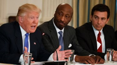 Donald Trump, left, meeting with manufacturing executives in February, including Merck's Kenneth Frazier, centre.