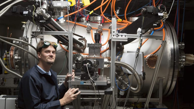 Program leader Tom McGuire stands next to the compact fusion reactor experiment inside his lab at the Skunk Works in Palmdale, California.