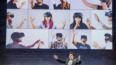 Palmer Luckey shows the numerous people will be using his headset.