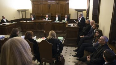 The defendants, including Francesca Chaouqui, against the wall on the right during their trial for allegedly leaking Vatican documents.