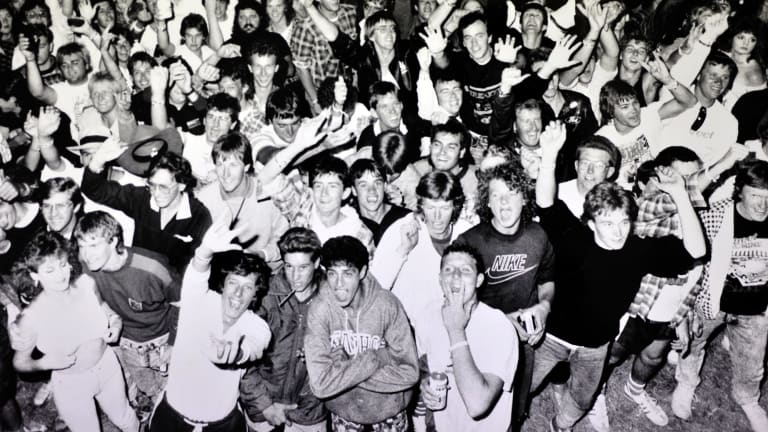 The Summernats crowd cheer in not only the New Year but also entrants in a wet T-shirt competition in December 1988.