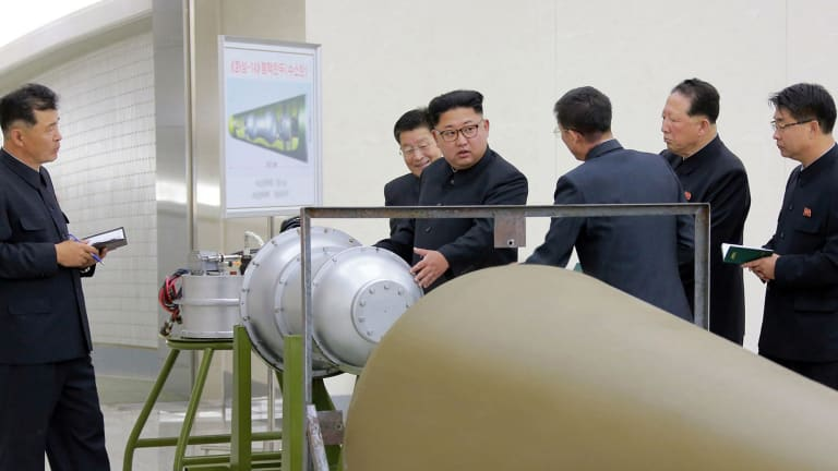 Image distributed on Sunday allegedly shows North Korean leader Kim Jong-un inspecting the loading of a hydrogen bomb into an intercontinental ballistic missile.