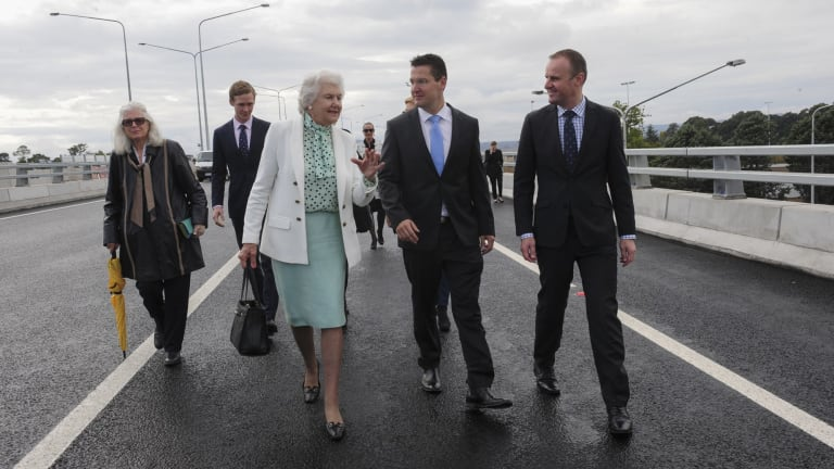 Tamie Fraser, wife of the late Malcolm Fraser, walks along the Malcolm Fraser Bridge and chats to Senator Zed Seselja and ACT Chief Minister Andrew Barr during its official opening.
