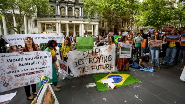 Brazilians protest outside BHP Billiton's headquarters in Melbourne on Friday.