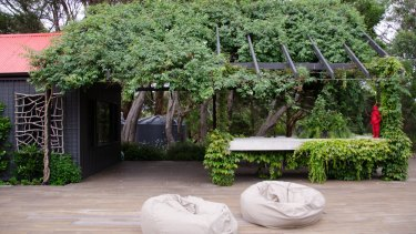 Musk Cottage's vast timber deck invites lazing around outdoors.