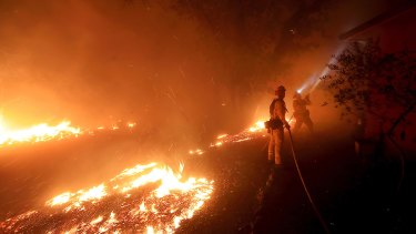 Firefighters protect a structure in Calistoga, California.
