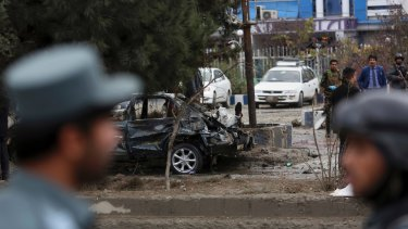 Afghan security personnel arrive at the site of the deadly suicide bombing.