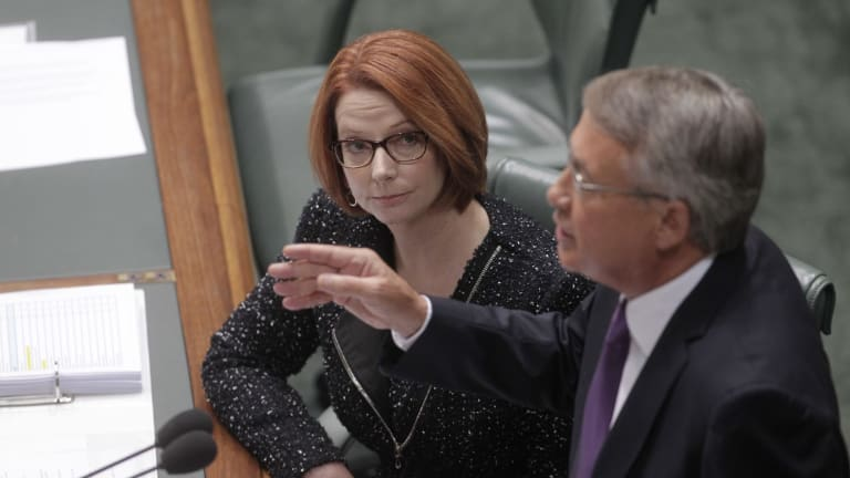 Julia Gillard and Wayne Swan in Parliament in 2013.