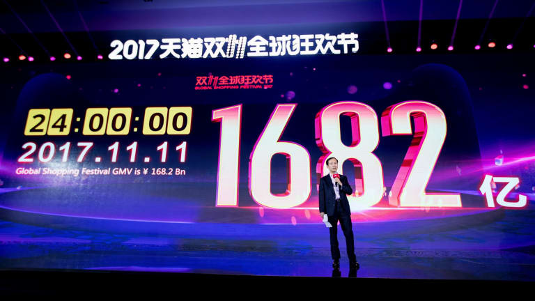 Daniel Zhang Yong, chief of China's largest e-commerce giant Alibaba Group, near a screen showing the amount of money consumers have spent after the conclusion of the Singles Day global online shopping festival in Shanghai, China,.