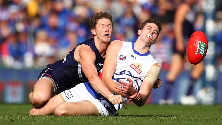 Spoiler alert: Fremantle's Zac Dawson gets the better of the contest against Zaine Cordy of the Bulldogs.
