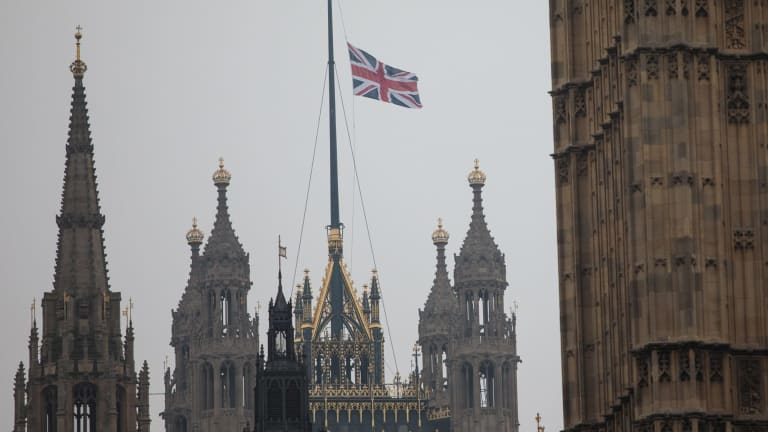 The Union Jack flag flies at half mast above the Houses of Parliament following the attack on Westminster.