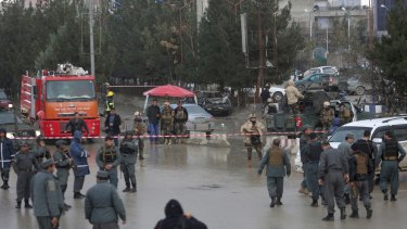 Afghan security personnel arrive at the site of the blast.