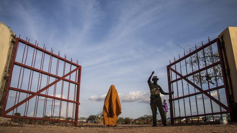 A police officer closes the gate between Bulo Hawa, Somalia, and Mandera, Kenya.