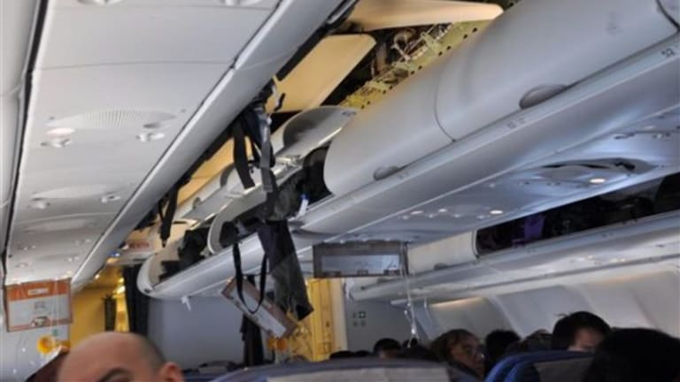 The impact of the nosedives dislodged compartment doors, signage and ceiling panels.