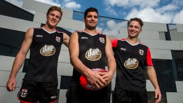 Milestone man: Leigh Montagna (centre) with Jack Newnes (left) and Jack Billings.