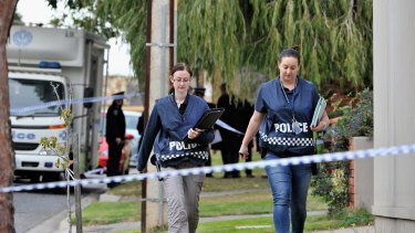 Police outside the home of Phil Walsh.