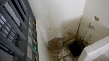 The shower area where authorities say drug lord Guzman, slipped into a tunnel to escape from the Altiplano maximum security prison in July 2015.