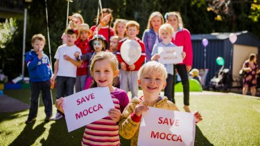 Hannah Claudianos, five, and Jack Rochester, three, join their fellow students to protest the closure of MOCCA.