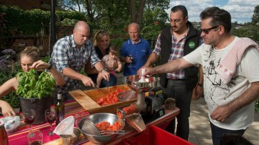 Chef Guy Grossi (right) got his hands dirty with family and friends in 2015.