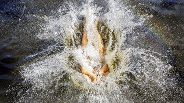 Issac, 17, cools off at Parramatta Lake on Saturday.