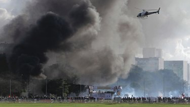 Smoke billows from fires started during violent demonstrators in Brasilia.