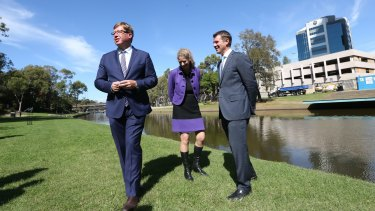 NSW Premier Mike Baird (right), Arts Minister Troy Grant and Powerhouse director Dolla Merrillees opposite the proposed new site of the museum on the Parramatta River.