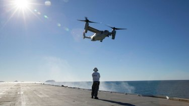 A US MV-22 Osprey takes off HMAS Canberra during exercise Talisman Saber.